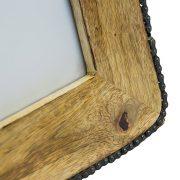 Drewniana ramka z łańcuchem od roweru jako obramówka