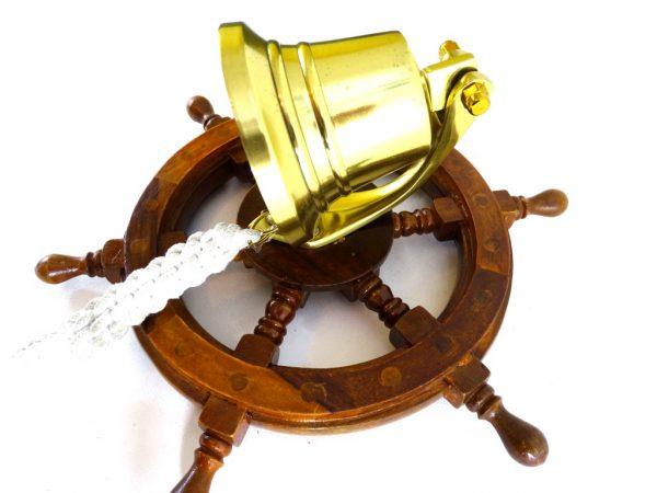 Dzwon mosiężny w drewnianym kole sterowym - 1